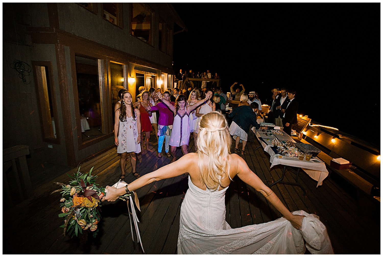 bride bouquet toss, outdoor colorado wedding, marble lodge wedding, marble colorado wedding, adventurous colorado wedding photographer