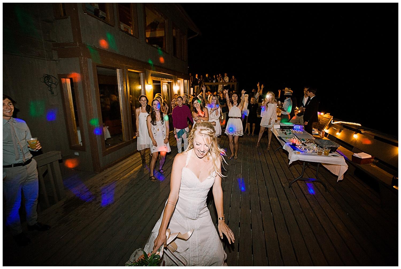 bride bouquet toss, outdoor colorado wedding, marble colorado wedding, marble lodge wedding, adventurous colorado wedding photographer