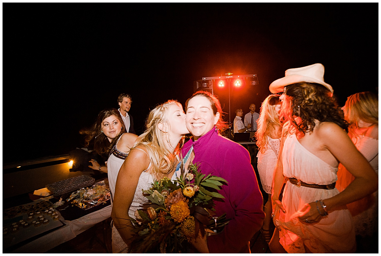 bride and bouquet toss, outdoor colorado wedding, marble colorado wedding, marble lodge wedding, adventurous colorado wedding photographer