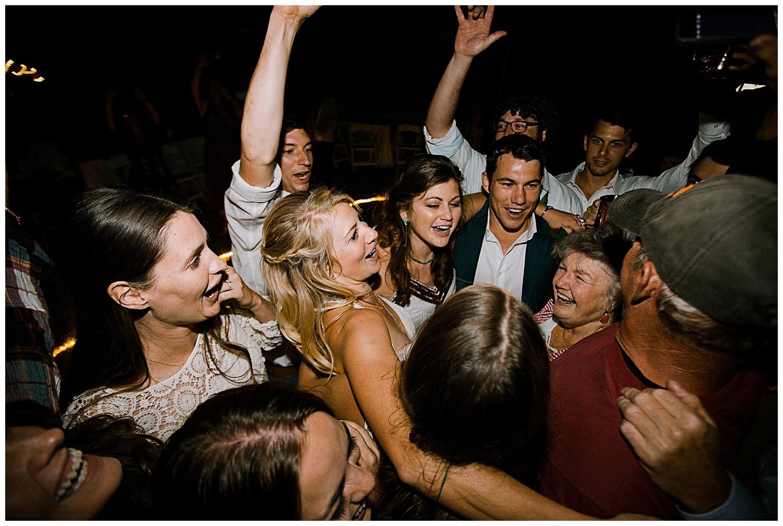 bride and groom at wedding reception, outdoor colorado wedding, marble colorado wedding, marble lodge wedding, adventurous colorado wedding photographer