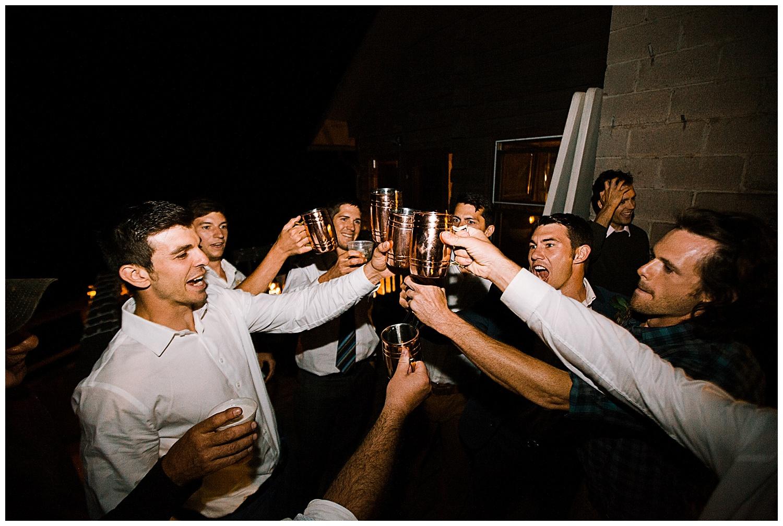 groom and groomsmen cheers, outdoor colorado wedding, marble colorado wedding, marble lodge wedding, adventurous colorado wedding photographer