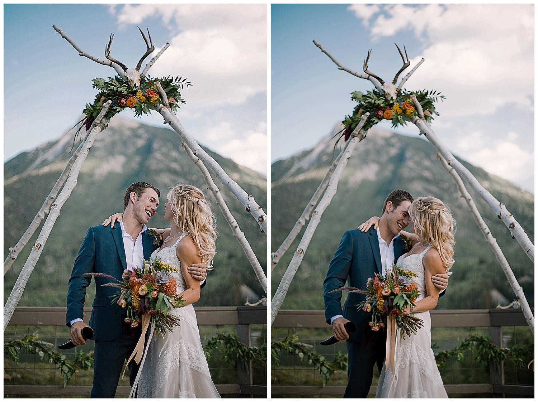 bride and groom, natural wedding arch with floral, outdoor colorado wedding, adventurous colorado wedding photographer, marble colorado wedding, marble lodge wedding