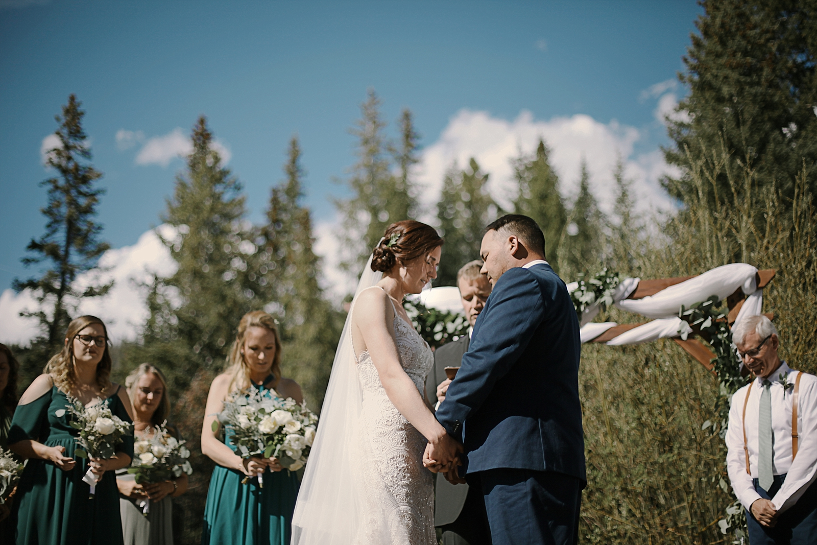 bride and groom saying their vows, breckenridge colorado wedding, breckenridge colorado wedding photographer, the church at agape outpost wedding, agape outpost wedding photographer