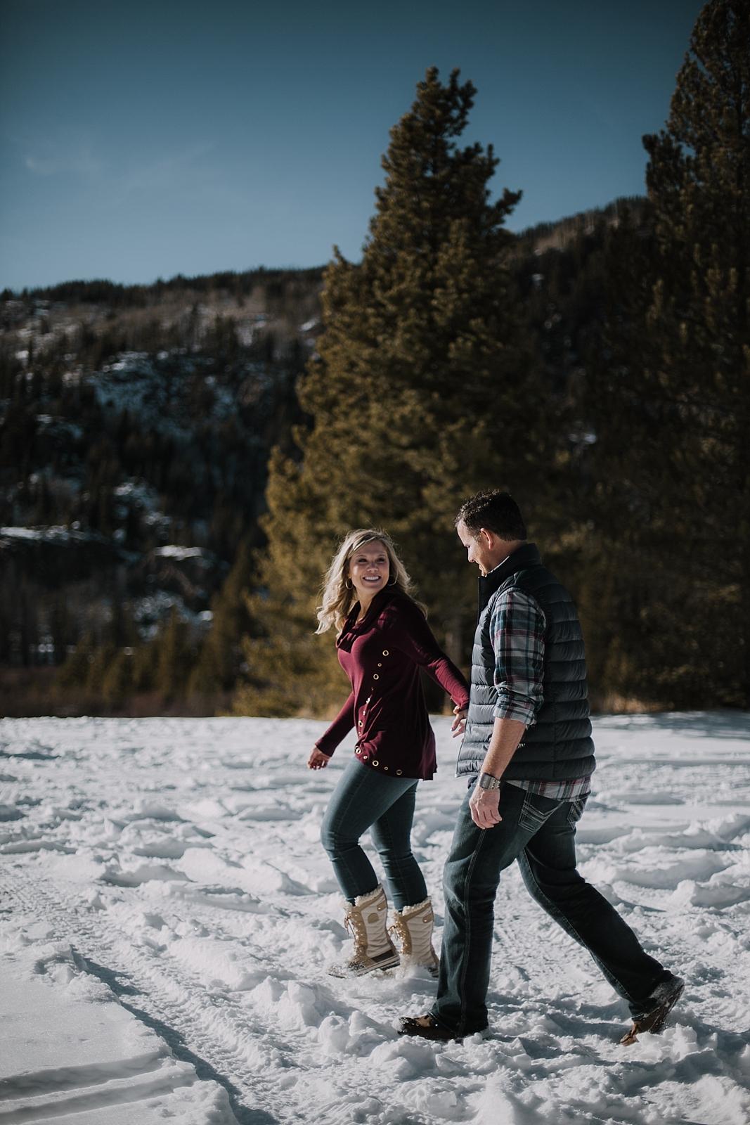 couple walking together, colorado adventure session, colorado engagement session, colorado wedding photographer, leadville wedding photographer, red cliff wedding photographer