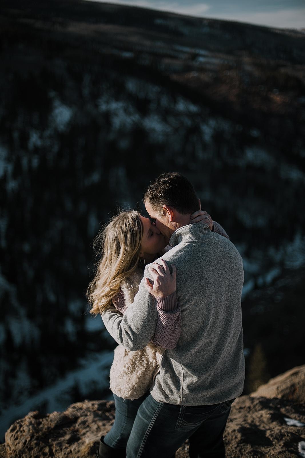 couple on cliffside, adventurous colorado engagements, adventurous colorado wedding photographer, red cliff wedding photographer, leadville wedding photographer