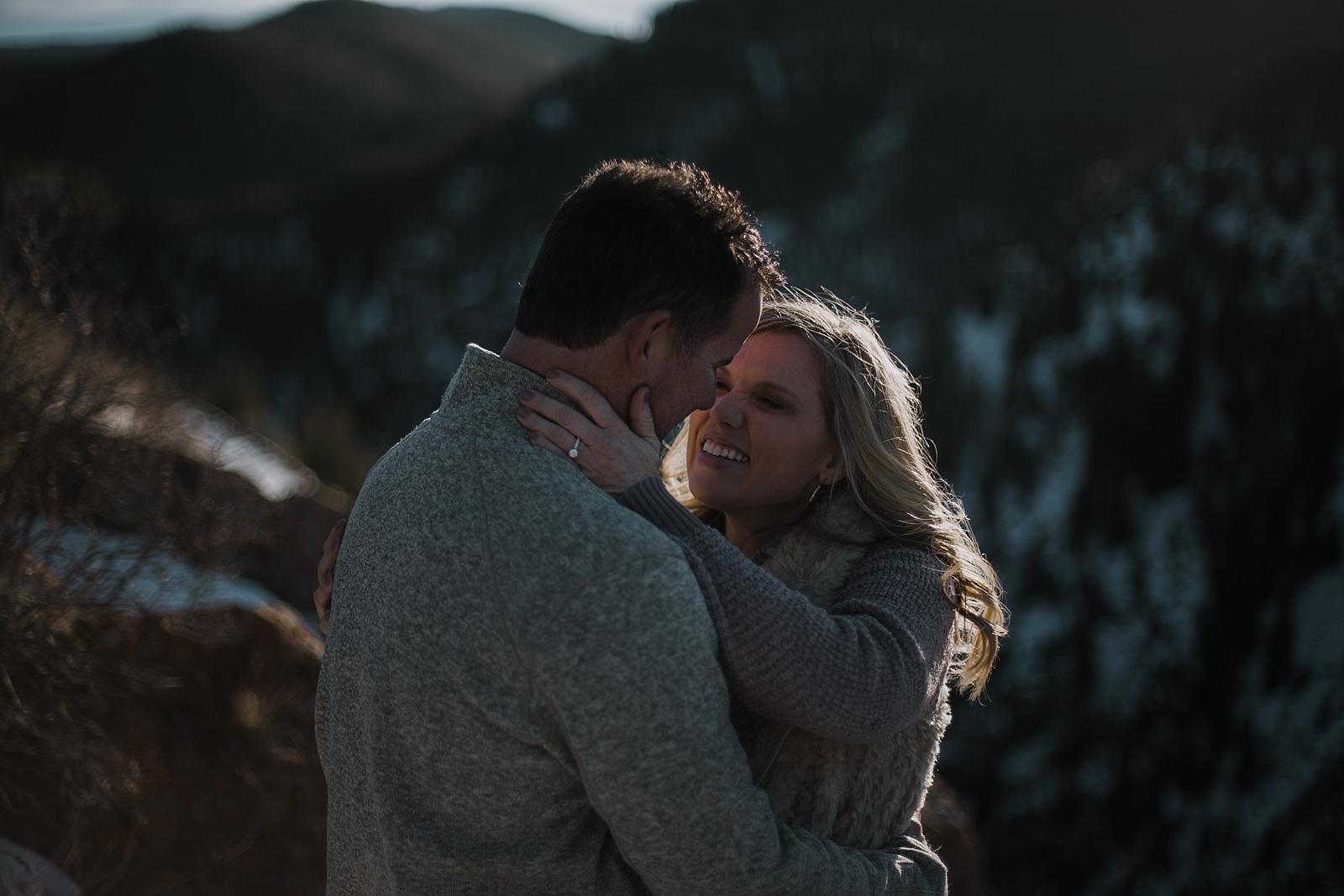 couple on cliffside, hiking photographer, hiking engagements, colorado wedding photographer, leadville wedding photographer, red cliff wedding photographer