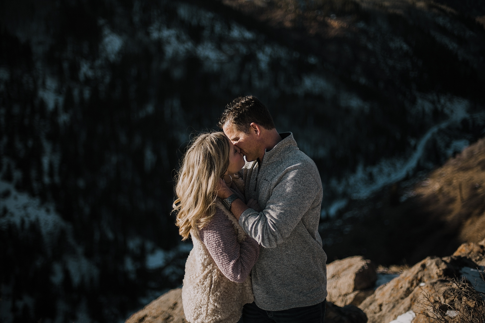 couple on cliffside, colorado hiking engagements, adventurous colorado engagements, adventurous colorado wedding photographer, red cliff wedding photographer, leadville wedding photographer