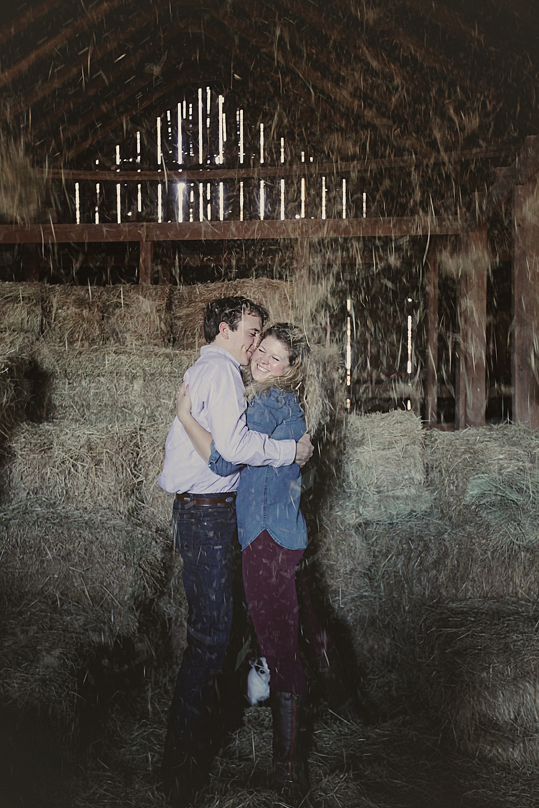 couple posing on haybale, rustic barn engagments, thomas oklahoma wedding photographer, weatherford oklahoma wedding photographer, oklahoma wedding photographer