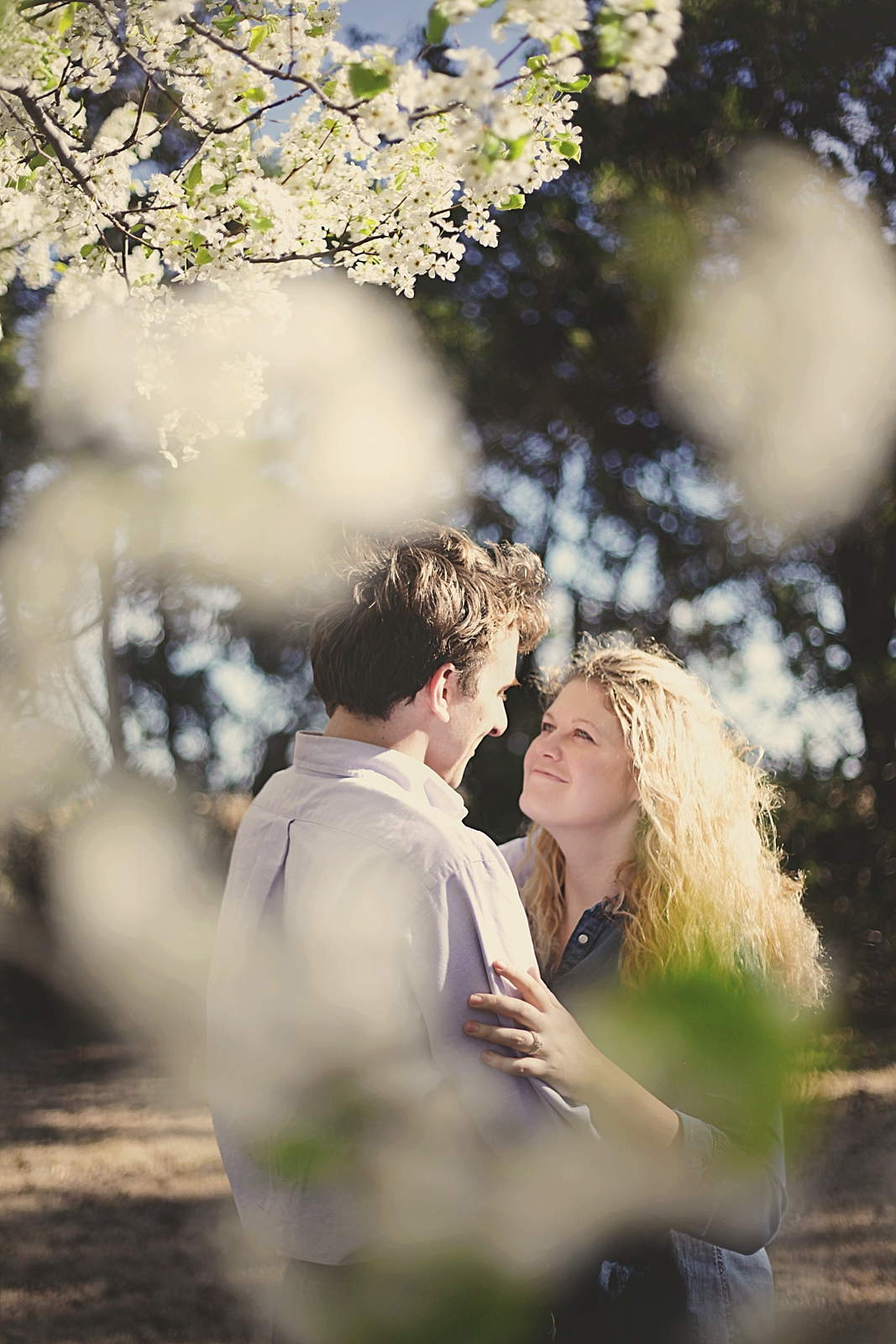 couple in orchard, engagements on a farm, thomas oklahoma wedding photographer, weatherford oklahoma wedding photographer