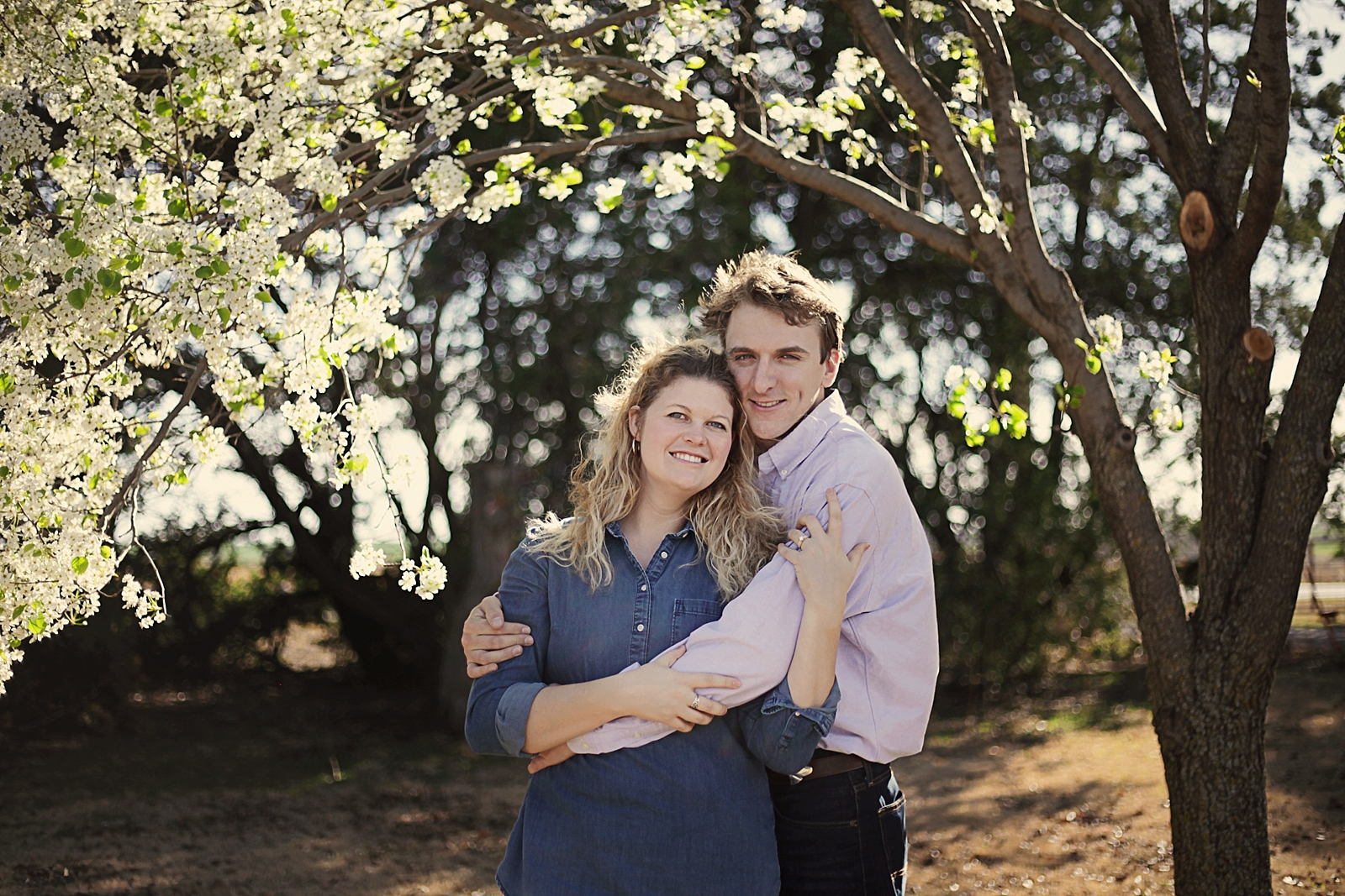 couple in an orchard, engagements on a farm, thomas oklahoma wedding photographer, weatherford oklahoma wedding photographer, oklahoma wedding photographer