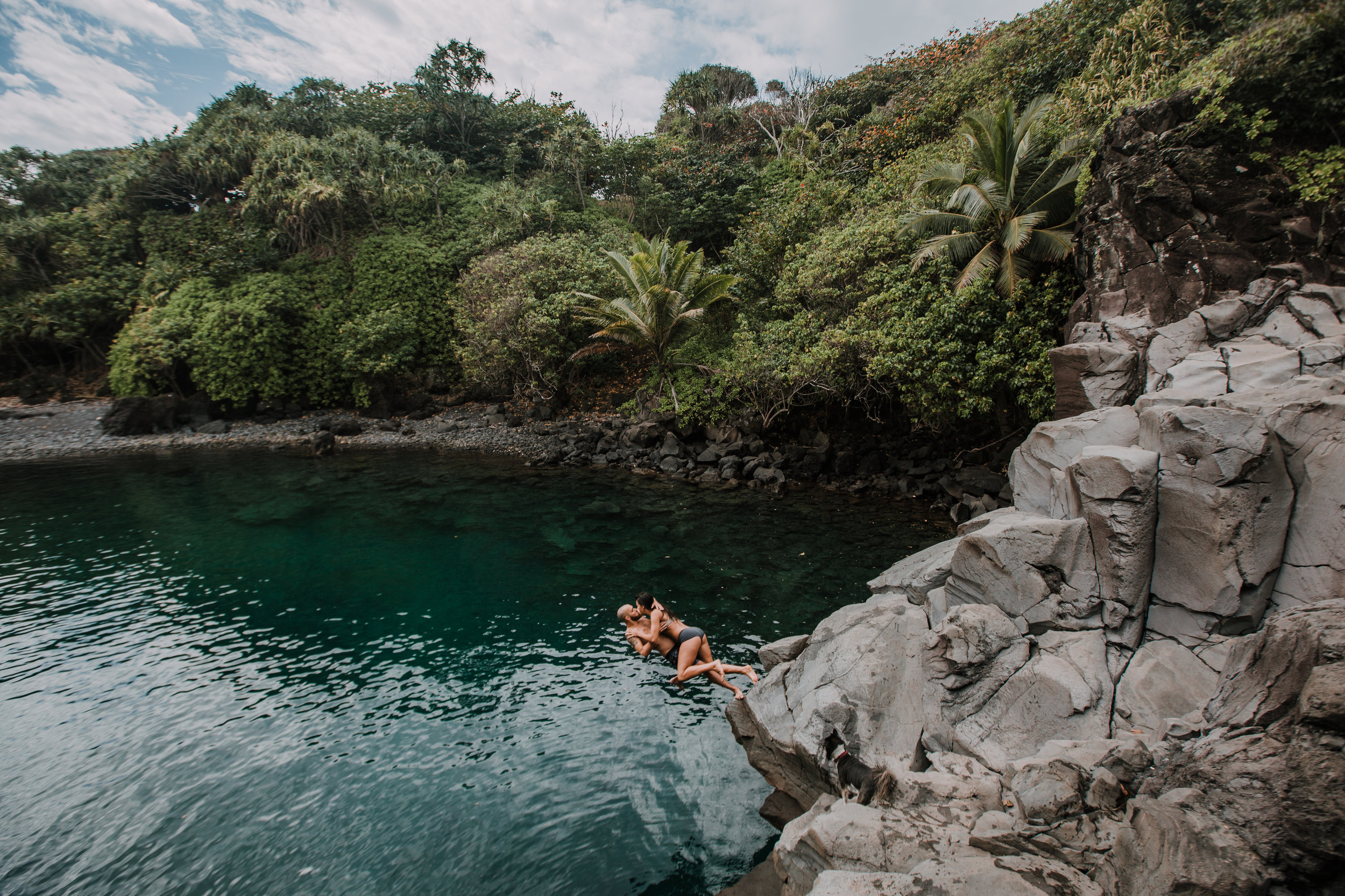 couple jumping off of cliff, seven sacred pools at ohe'o, island hiking, road to hana, hawaii wedding photographer, hawaii elopement photographer, maui wedding, maui engagements, maui elopement