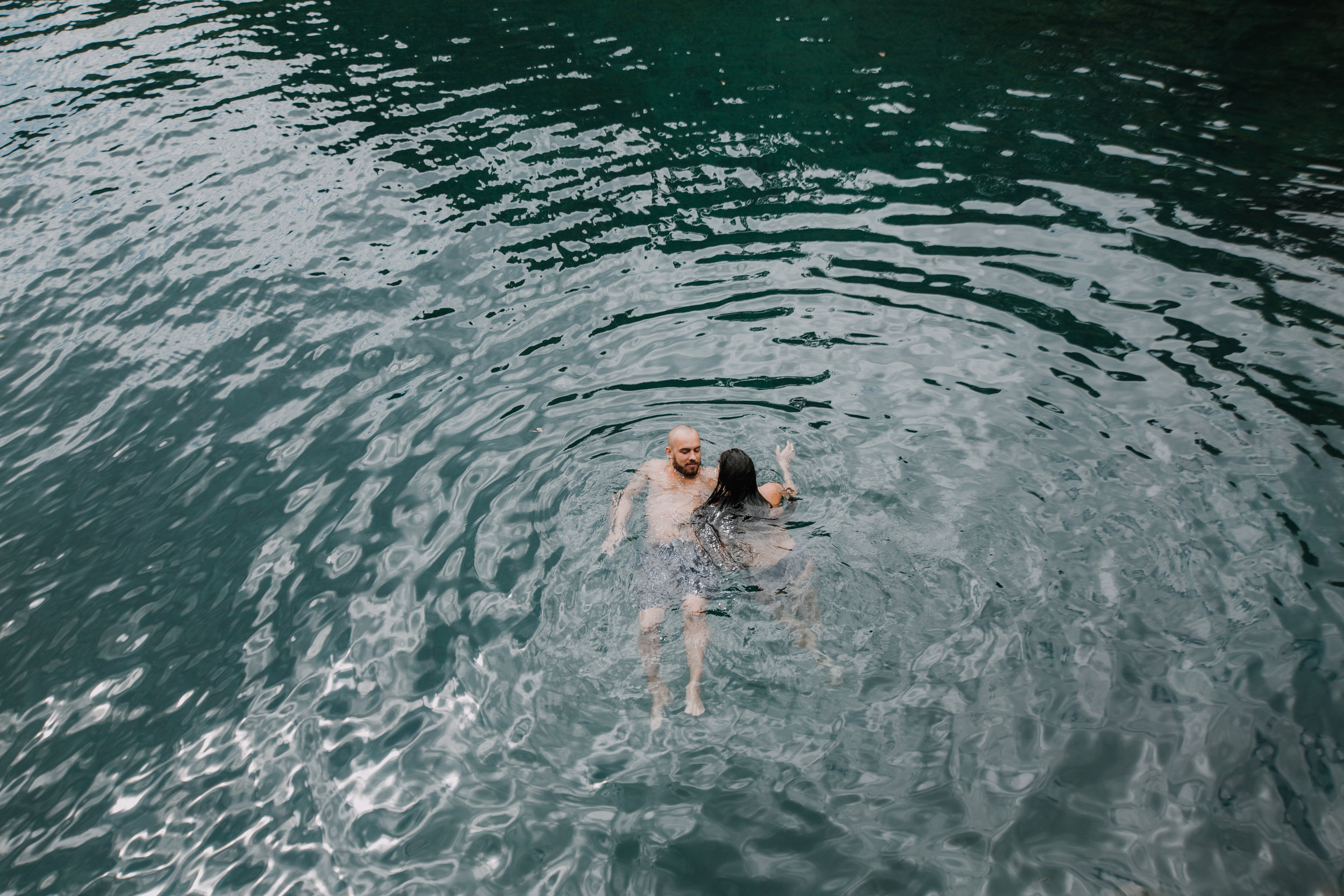 couple swimming, seven sacred pools at ohe'o, island hiking, road to hana, hawaii wedding photographer, hawaii elopement photographer, maui wedding, hana swimming, maui engagements, maui elopement