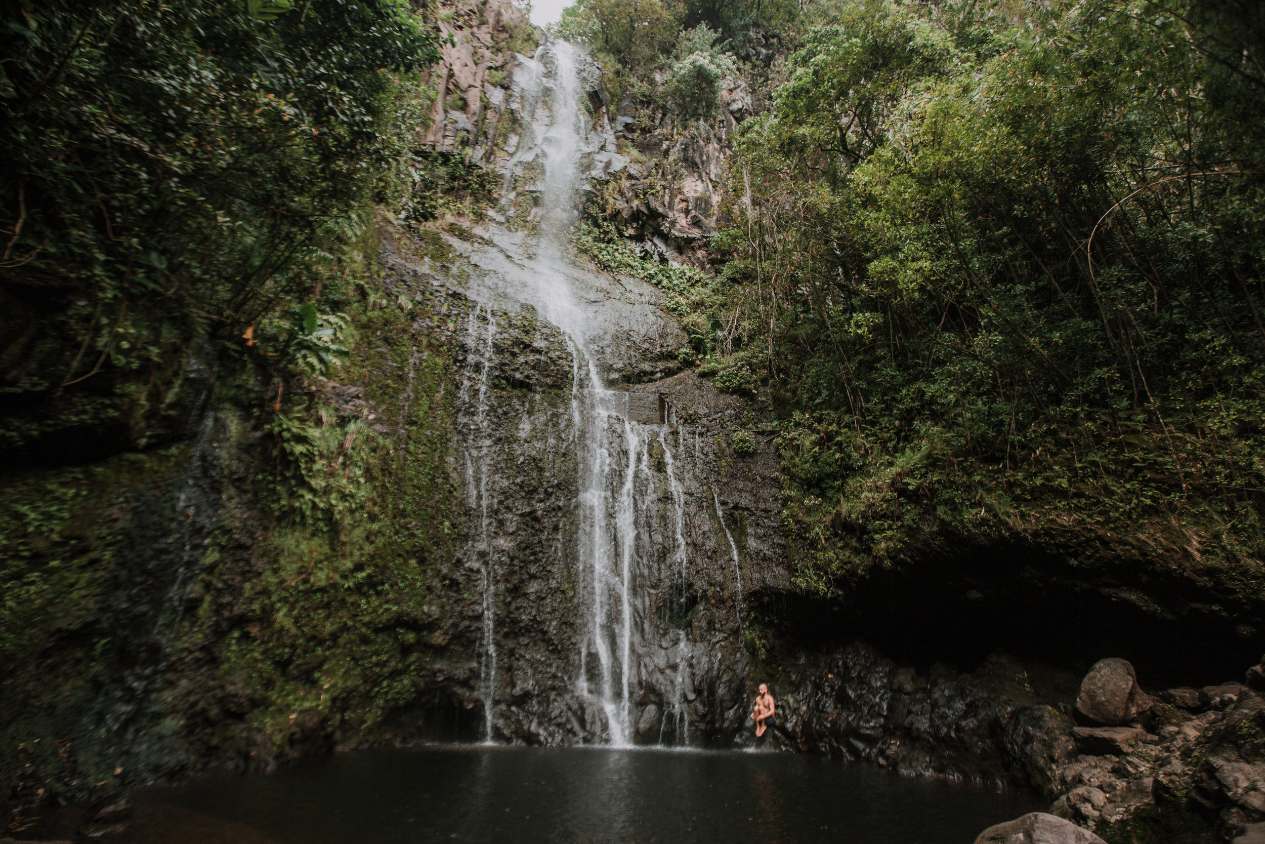 jumping into a hana maui waterfall, hawaii waterfall, road to hana, maui waterfall, hawaii wedding photographer, hawaii elopement photographer, maui wedding, maui engagements, maui elopement