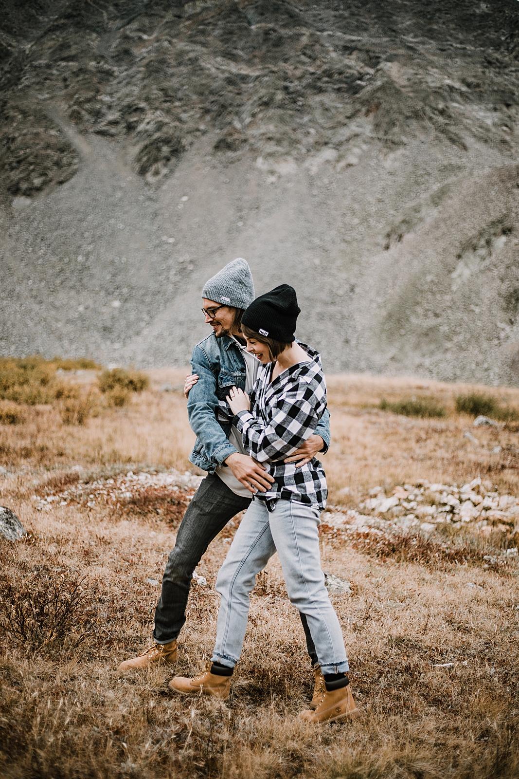 couple laughing, colorado surprise proposal, hike mayflower gulch, mayflower gulch proposal, mayflower gulch elopement, mayflower gulch wedding, colorado mountainscape, leadville elopement