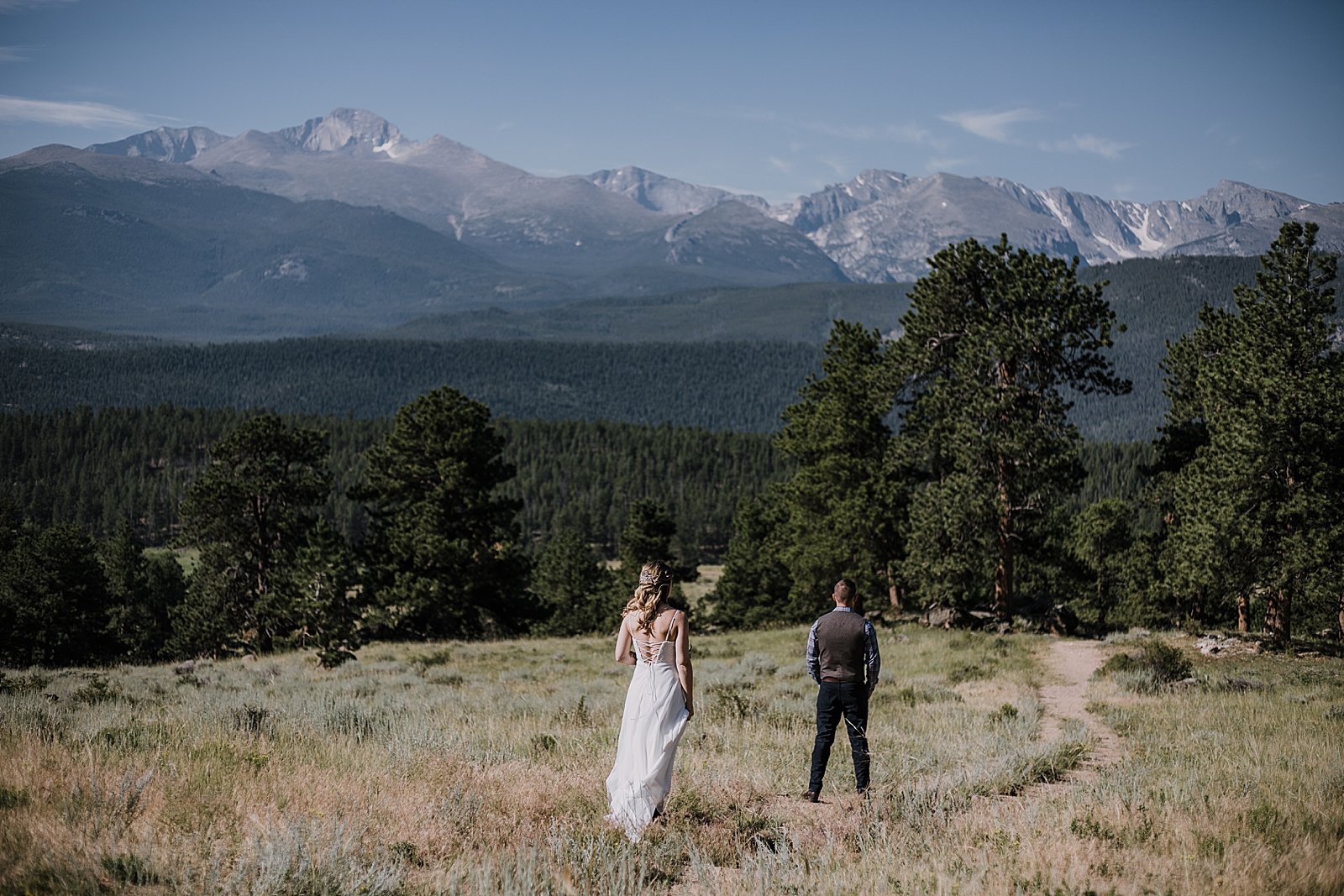 wedding couple first look, rocky mountain national park elopement, 3M curves elopement, self solemnizing, self solemnization, long's peak ceremony, hiking elopement, estes park elopement