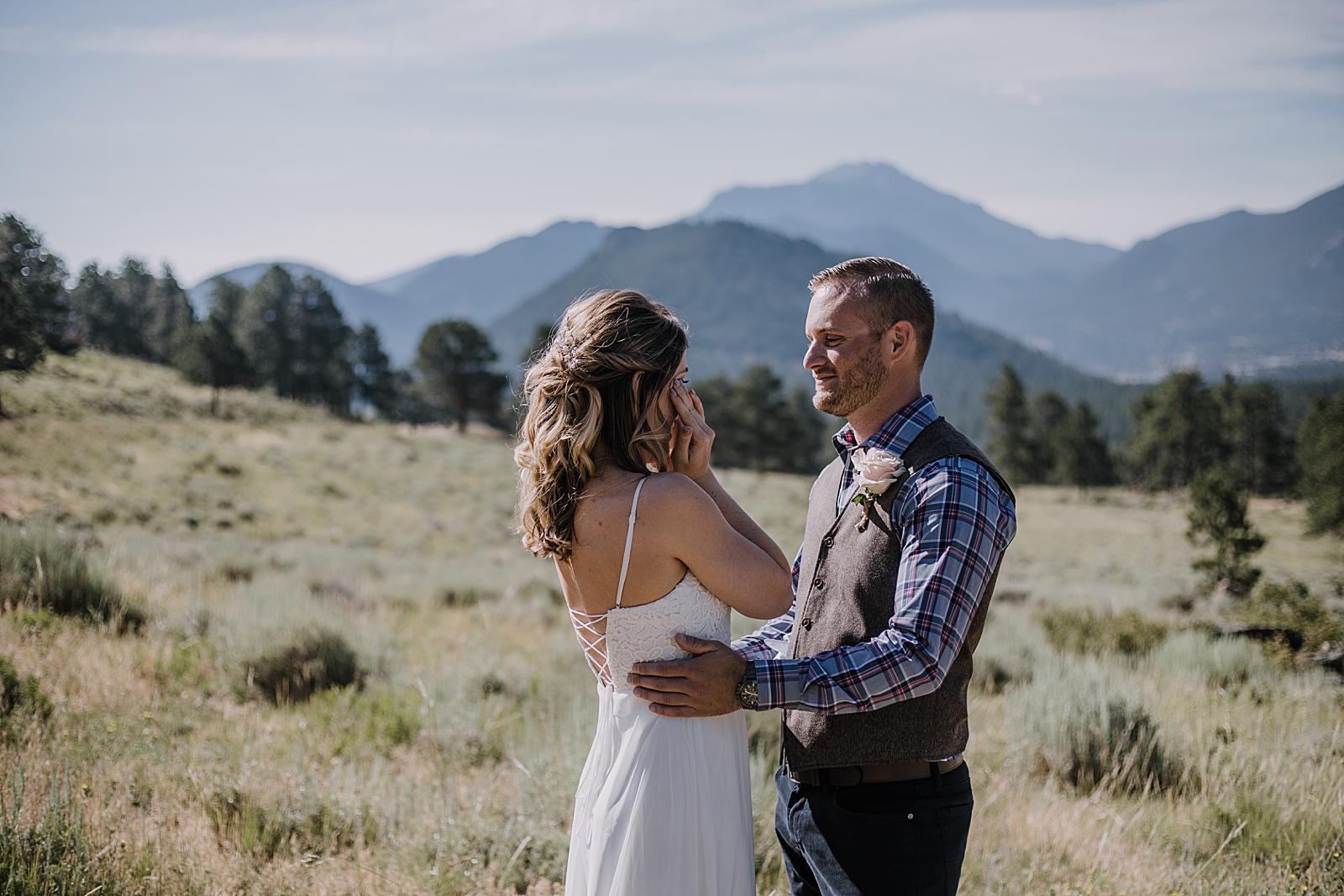 bride tearing up, rocky mountain national park elopement, 3M curves elopement, self solemnizing, self solemnization, long's peak ceremony, hiking elopement, estes park elopement