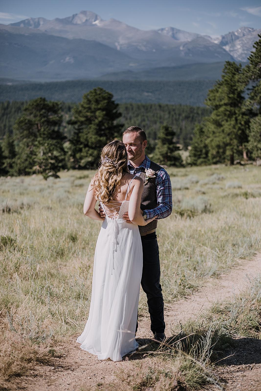 couple hugging, rocky mountain national park elopement, 3M curves elopement, self solemnizing, self solemnization, long's peak ceremony, hiking elopement, estes park elopement