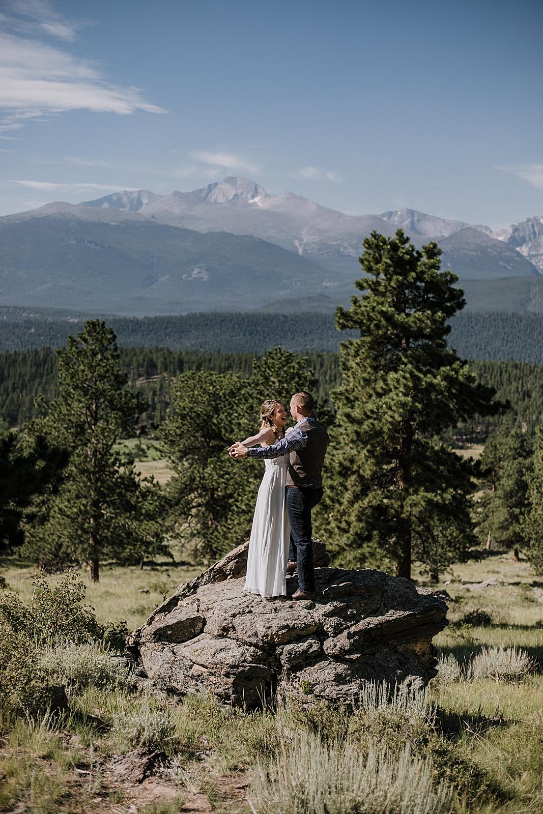 couple celebrating, RMNP elopement ceremony, rocky mountain national park elopement, 3M curves elopement, self solemnizing, self solemnization, long's peak, hiking elopement, estes park elopement