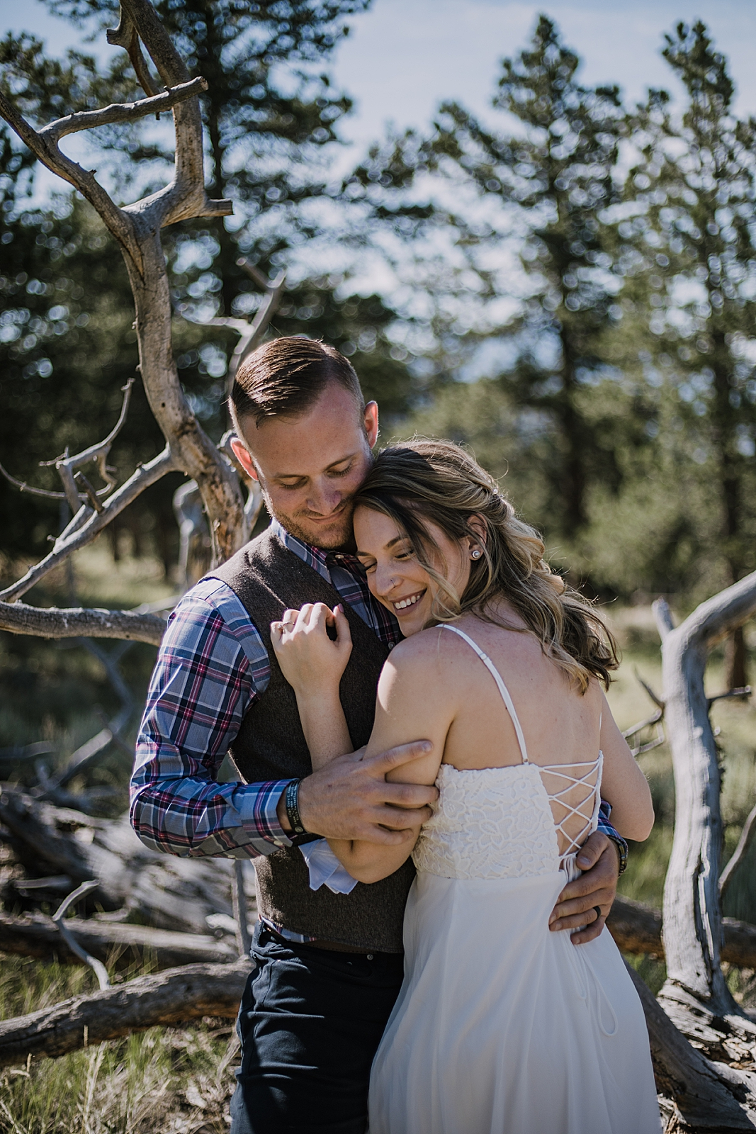 couple cuddling, RMNP elopement ceremony, rocky mountain national park elopement, 3M curves elopement, self solemnizing, self solemnization, long's peak, summer hiking elopement, estes park elopement
