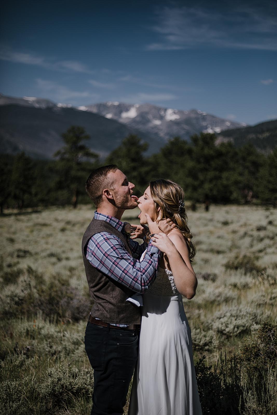 groom licks bride, RMNP elopement ceremony, rocky mountain national park elopement, 3M curves elopement, self solemnizing, self solemnization, long's peak, summer elopement, estes park elopement