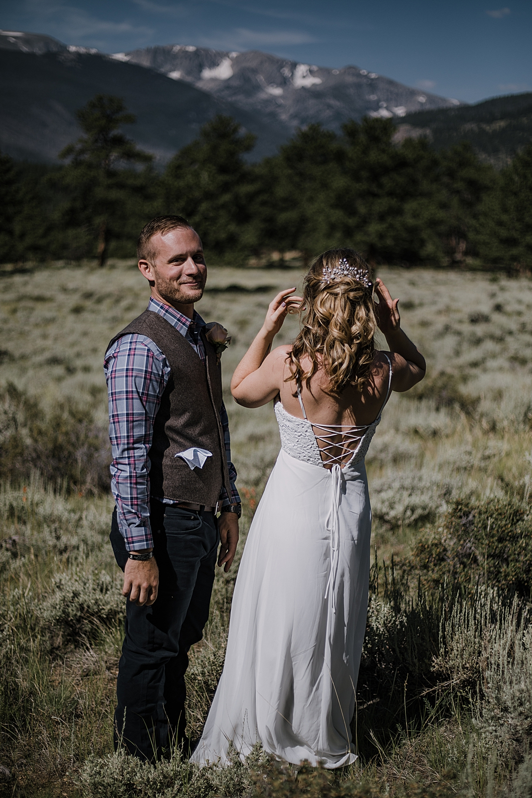 groom laughing, RMNP elopement ceremony, rocky mountain national park elopement, 3M curves elopement, self solemnizing, self solemnization, long's peak, summer elopement, estes park elopement