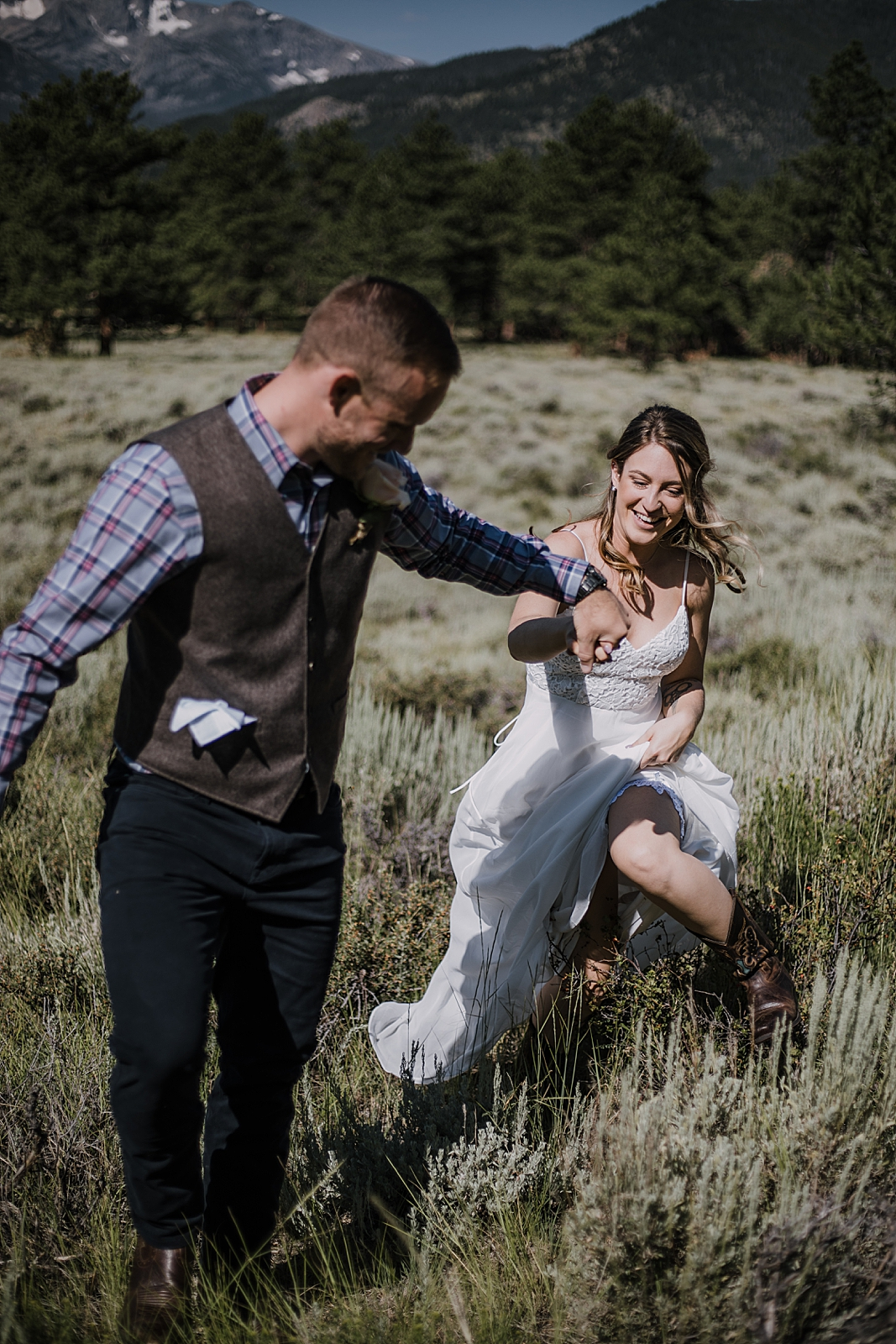 groom and bride running, RMNP elopement ceremony, rocky mountain national park elopement, 3M curves elopement, self solemnizing, self solemnization, long's peak, summer elopement, estes park elopement