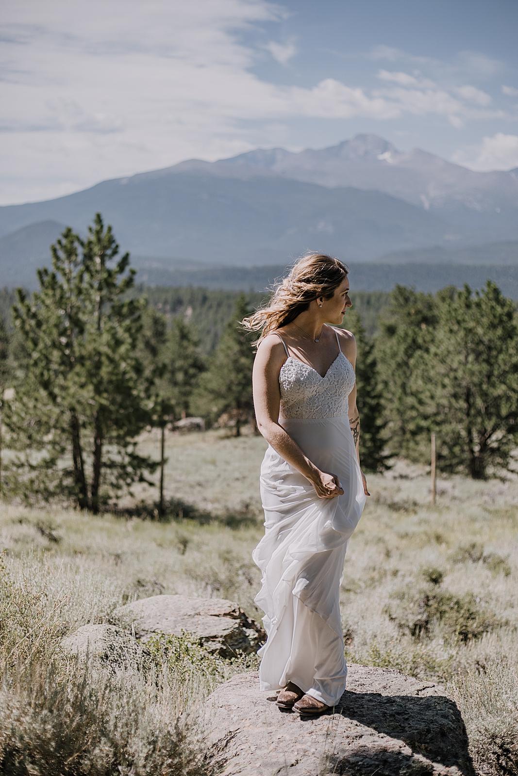 bride in wedding dress, RMNP elopement ceremony, rocky mountain national park elopement, 3M curves elopement, self solemnizing, self solemnization, long's peak, summer elopement, estes park elopement