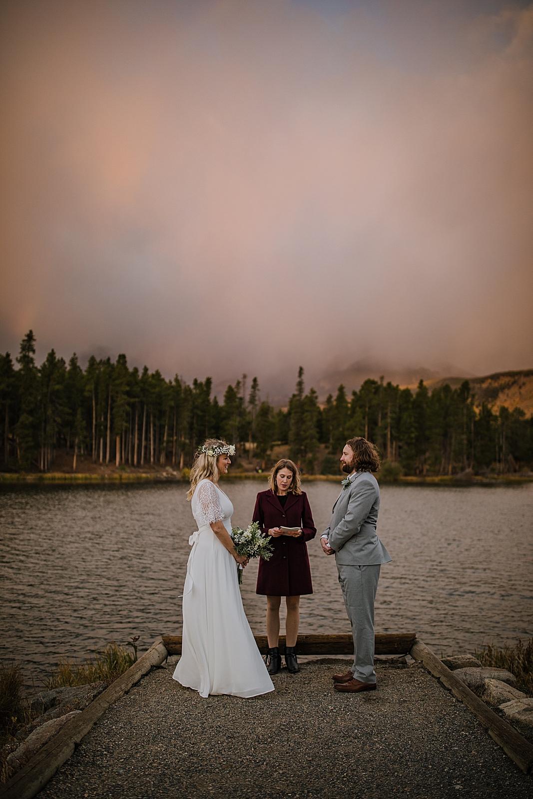 sprague lake dock elopement ceremony, sunrise elopement, colorado elopement, sprague lake elopement, sprague lake wedding, rocky mountain national park elopement, adventurous colorado hiking elopement