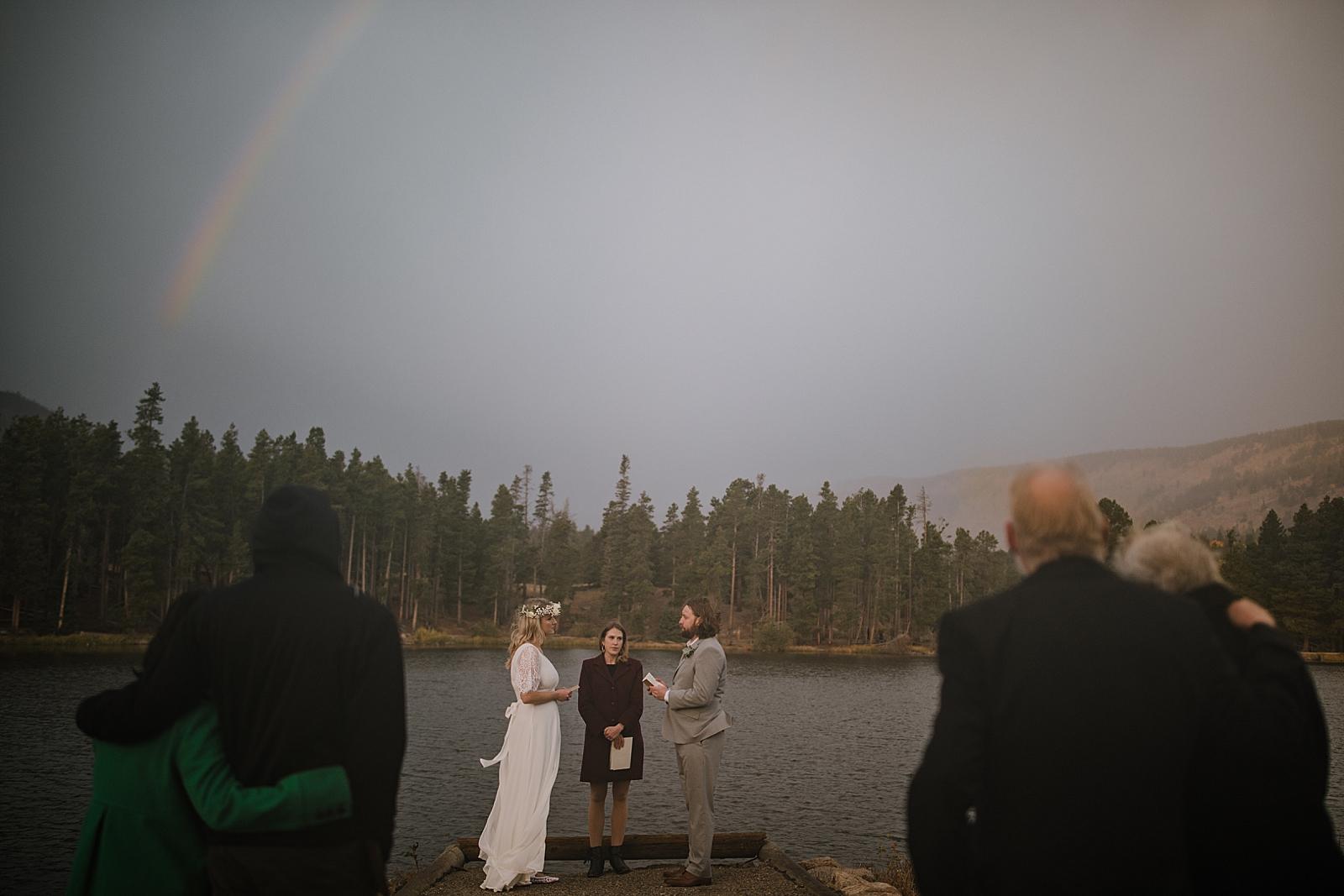 sprague lake dock elopement, sunrise elopement, colorado elopement, sprague lake elopement, rain on wedding day, rocky mountain national park elopement, adventurous colorado hiking elopement