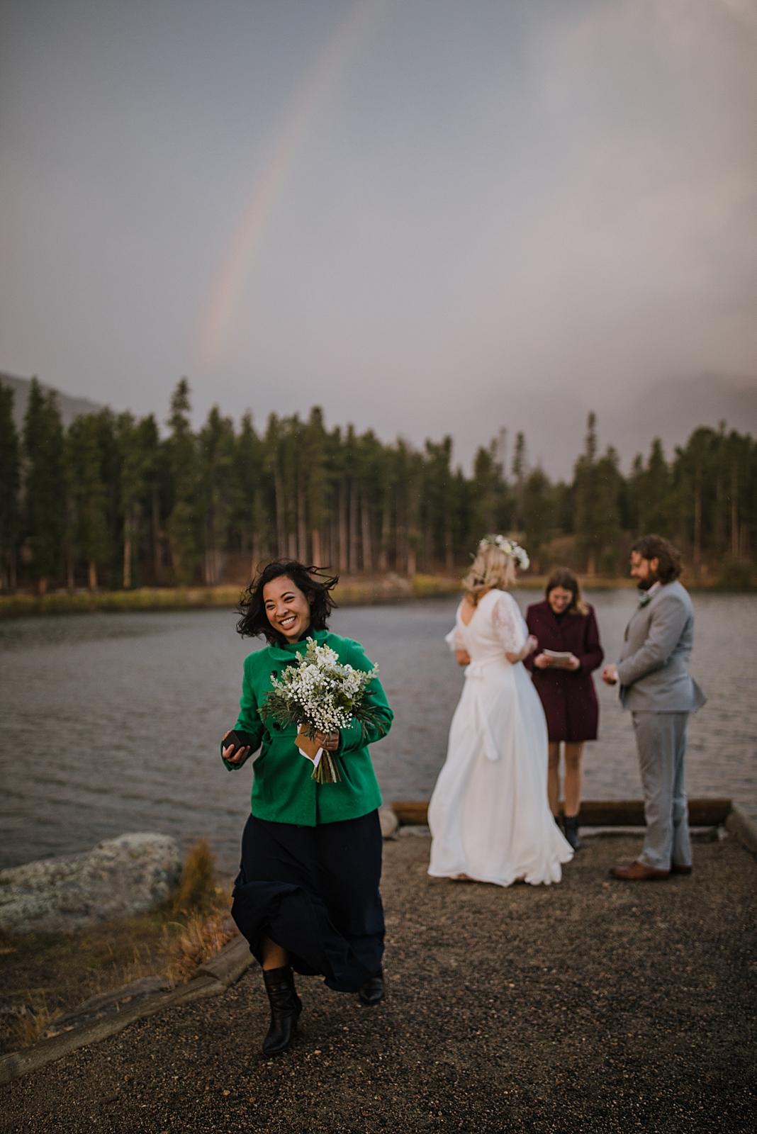 bride and groom wedding rings, sprague lake dock elopement, sunrise elopement, colorado elopement, sprague lake elopement, rocky mountain national park elopement, adventurous colorado hiking elopement