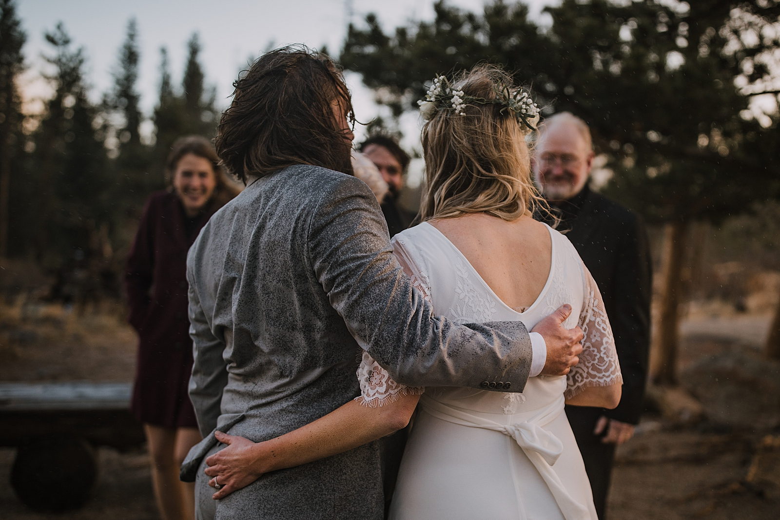 bride and groom soaked, sprague lake dock elopement, sunrise elopement, colorado elopement, sprague lake elopement, rocky mountain national park elopement, adventurous colorado hiking elopement