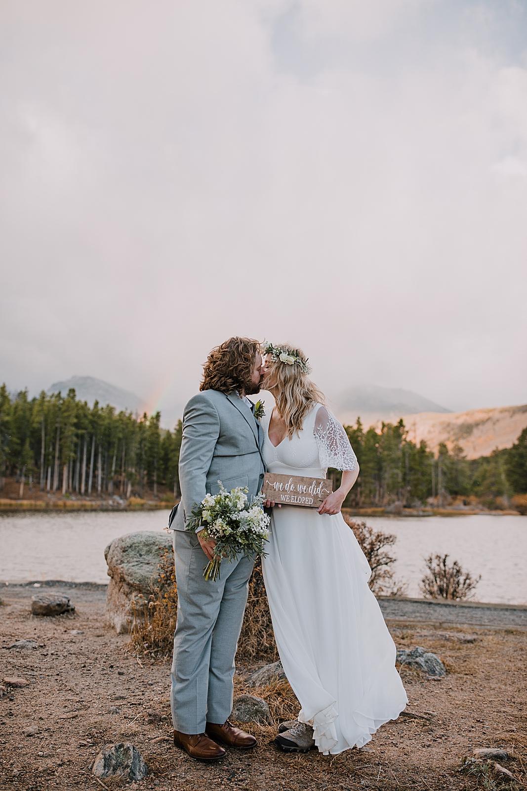 elopement couple kissing, sprague lake dock elopement, sunrise elopement, colorado elopement, sprague lake elopement, rocky mountain national park elopement, adventurous colorado hiking elopement