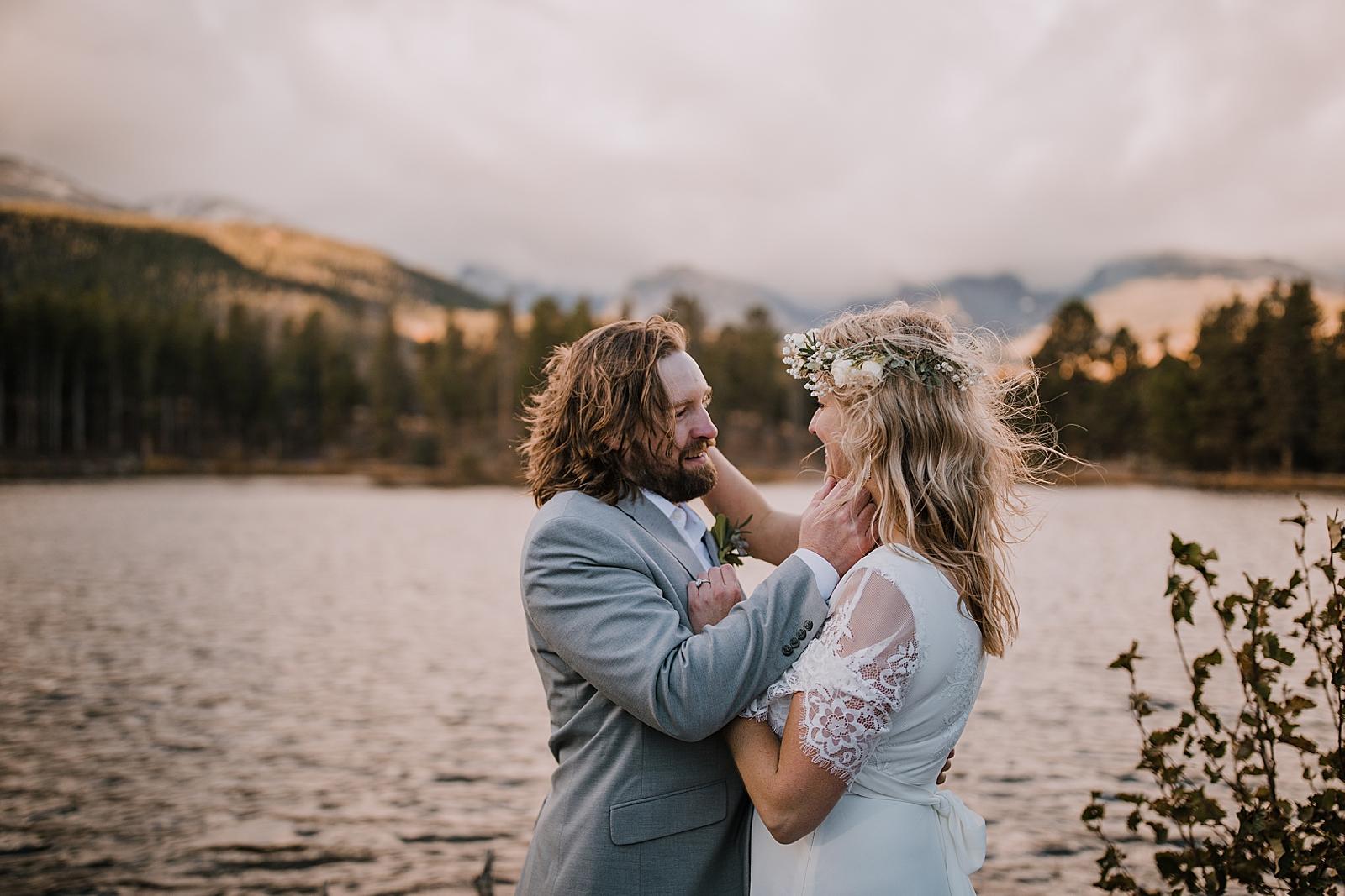 hiking bride and groom, sprague lake dock elopement, sunrise elopement, colorado elopement, sprague lake elopement, rocky mountain national park elopement, adventurous colorado hiking elopement