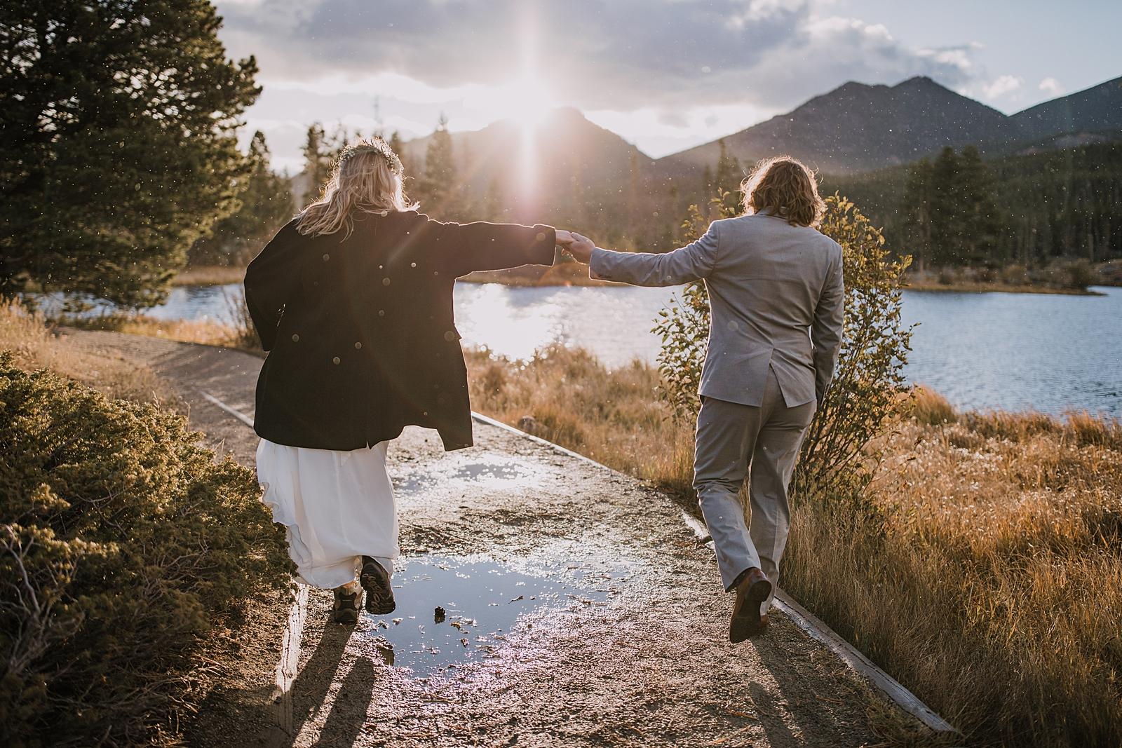 couple hiking in sun rain, rocky mountain national park elopement, self solemnize in rocky mountain national park, estes park elopement, sprague lake elopement