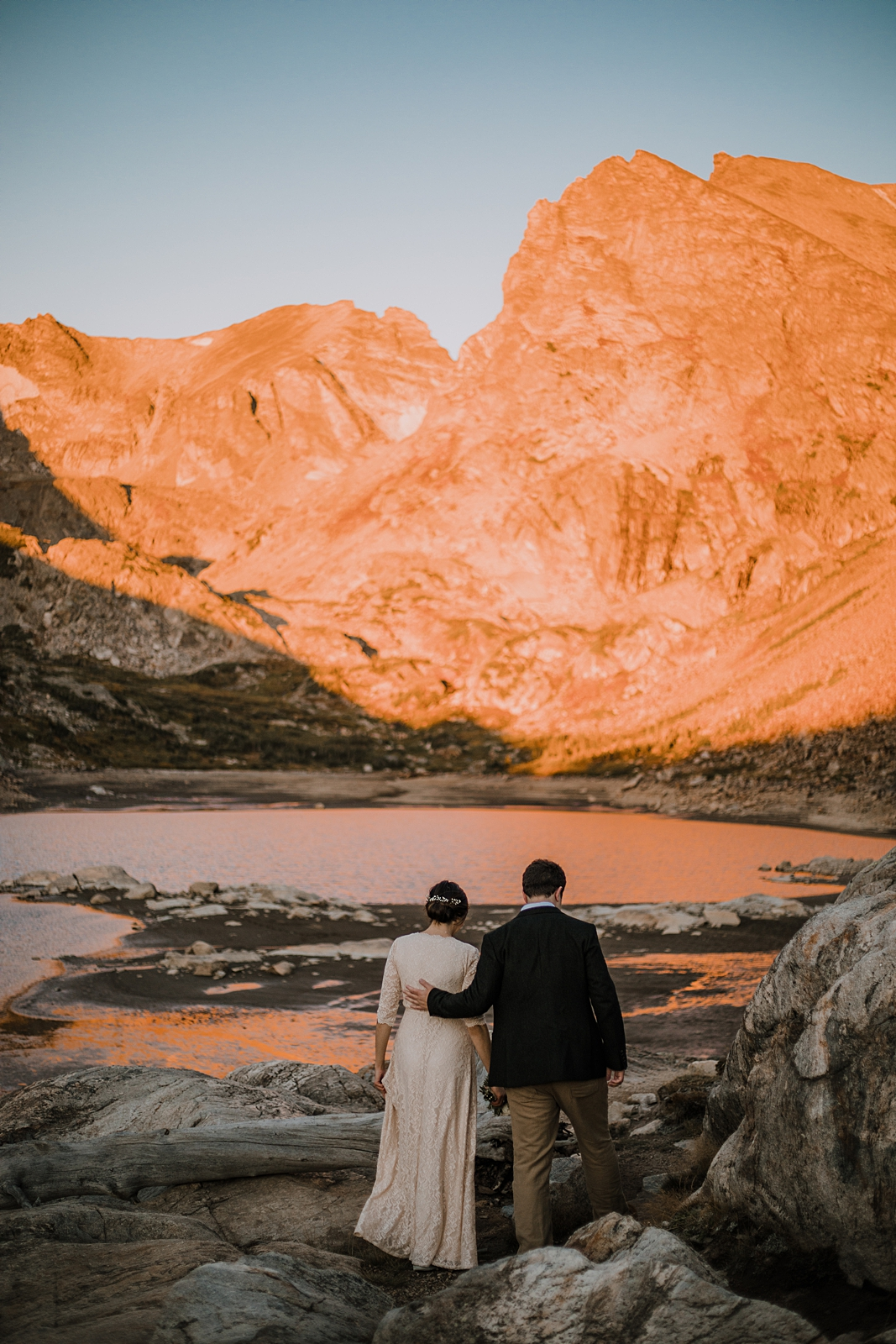 couple hiking in the indian peaks wilderness area, sunrise elopement at lake isabelle colorado, indian peaks hiking elopement, alpine glow on the indian peaks colorado