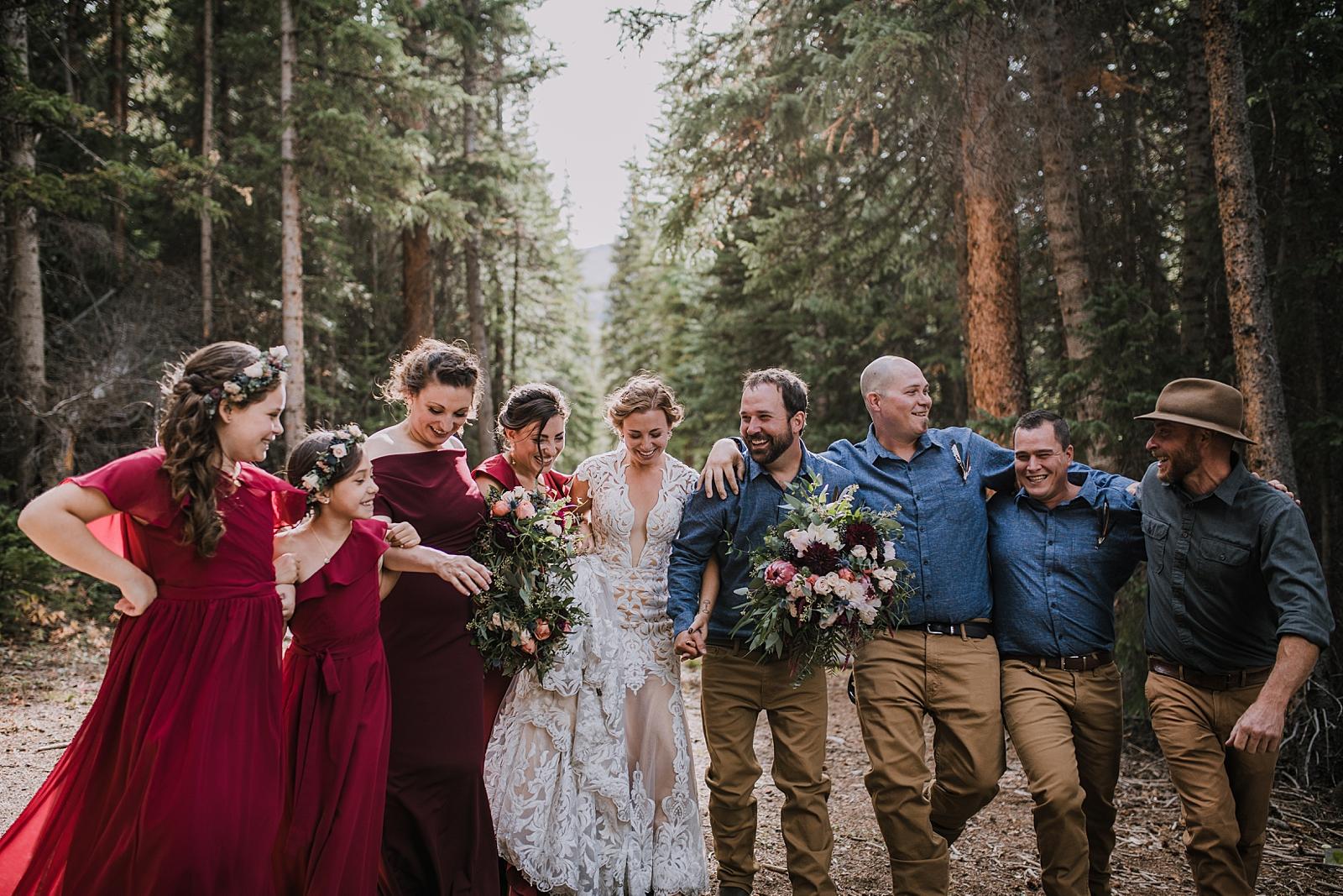 groom holding veil, hiking the cucumber gulch trail in breckenridge colorado, breckenridge nordic center summer wedding, summer wedding in breckenridge colorado, hiking the breckenridge nordic trails