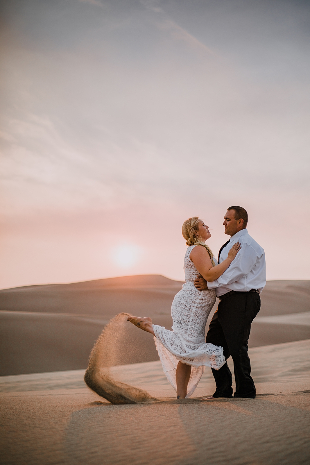 couple hiking the great sand dunes near crestone colorado, great sand dunes national park hiking, great sand dunes national park sunset elopement, elope at the great sand dunes