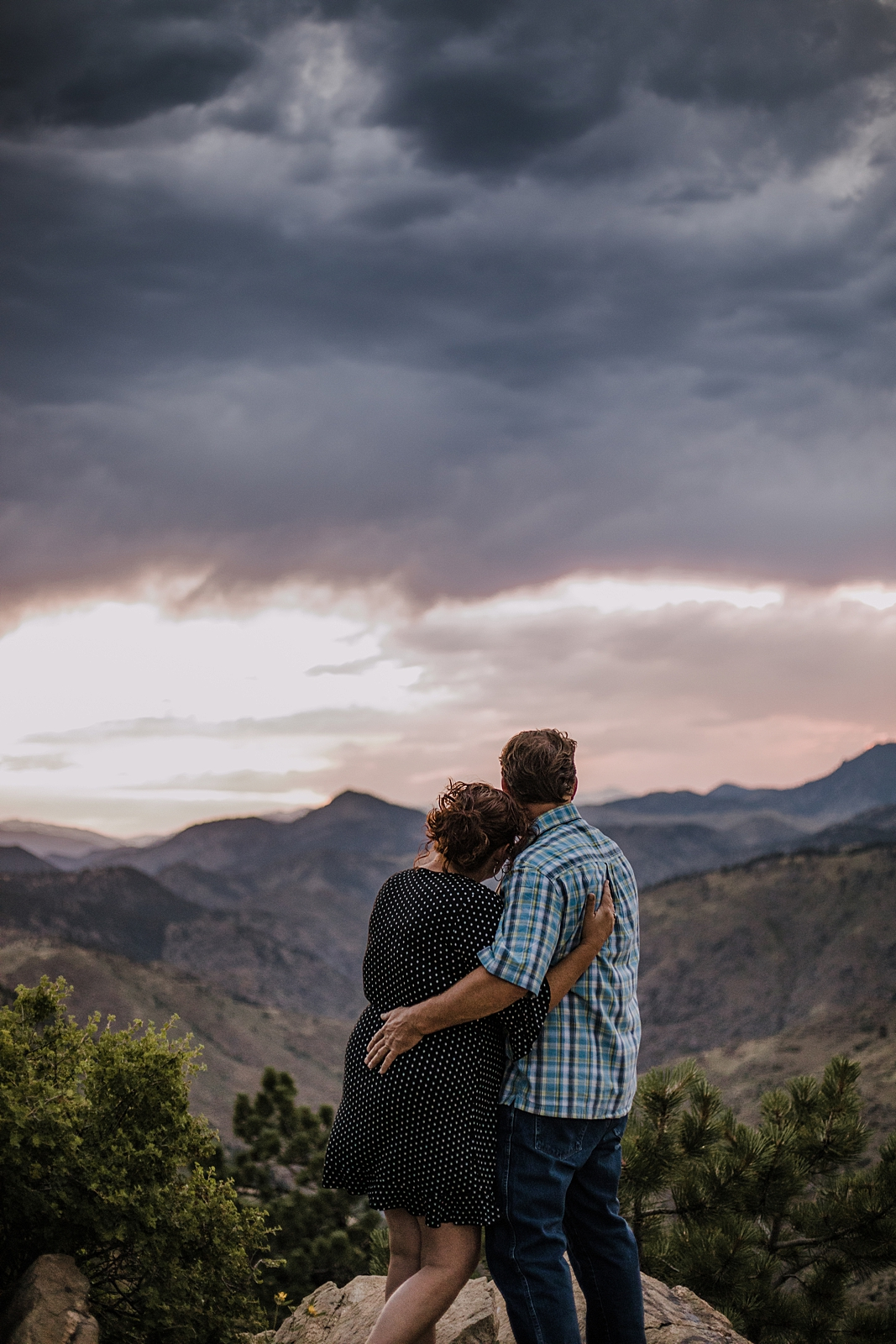 couple taking in the view, sunset on top of lookout mountain near golden colorado, lookout mountain engagements, lookout mountain hiking trails