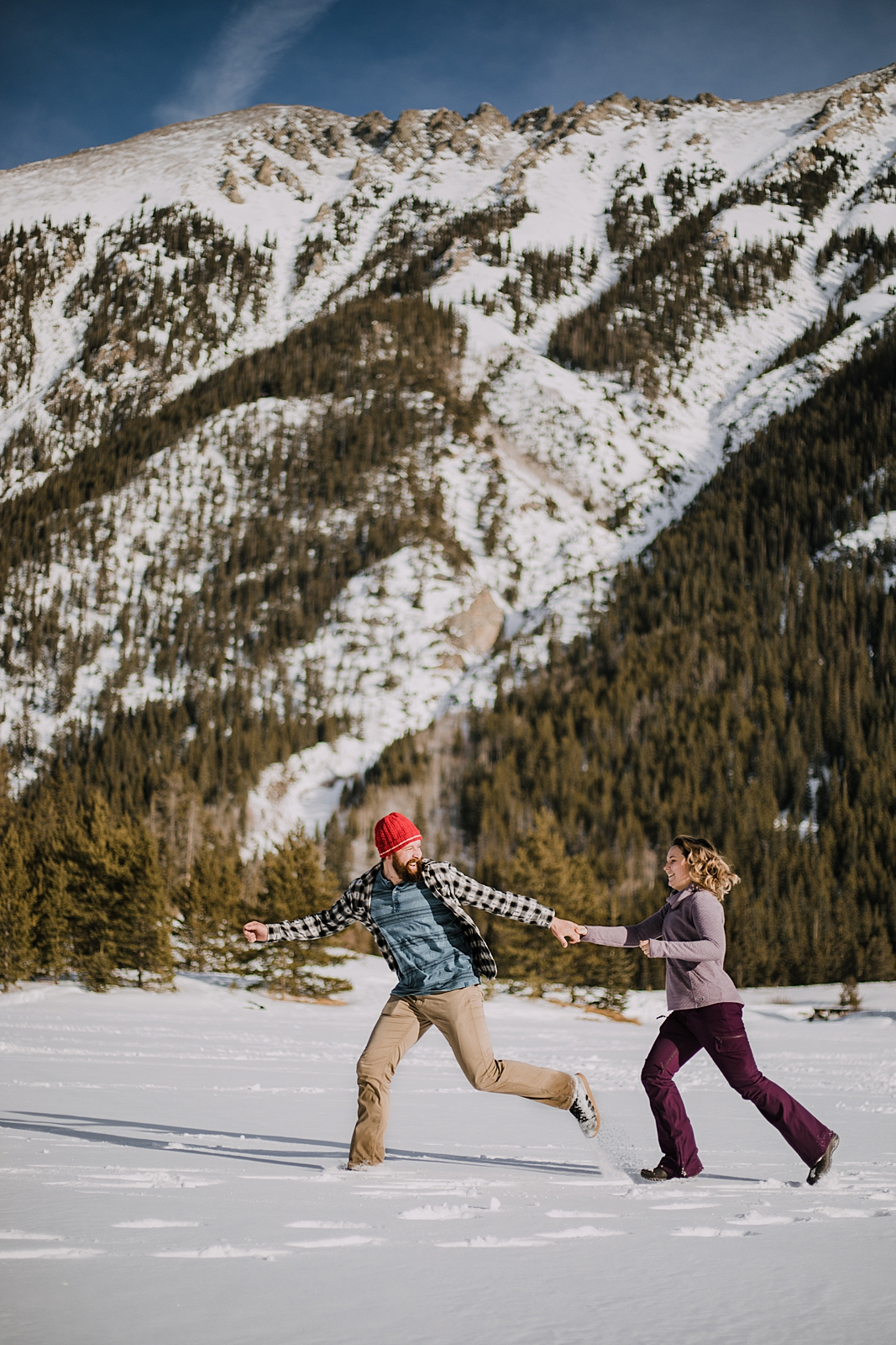 couple playing in the snow, officers gulch colorado elopement, hiking officers gulch near frisco and copper colorado, snowy colorado engagements
