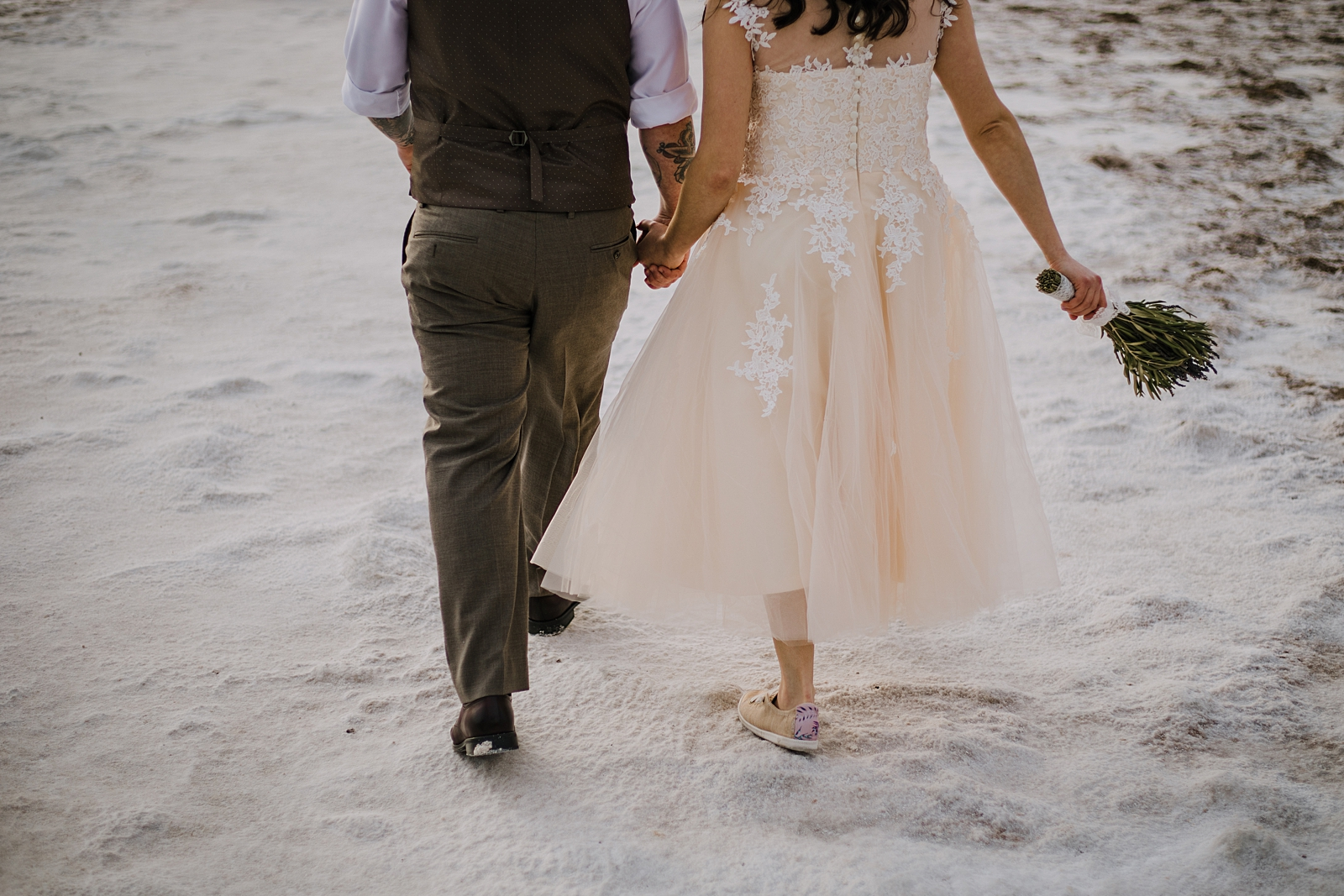 couple hiking the salt flats, death valley national park elopement, elope in death valley, badwater basin elopement, hiking in death valley national park, sunset at badwater basin