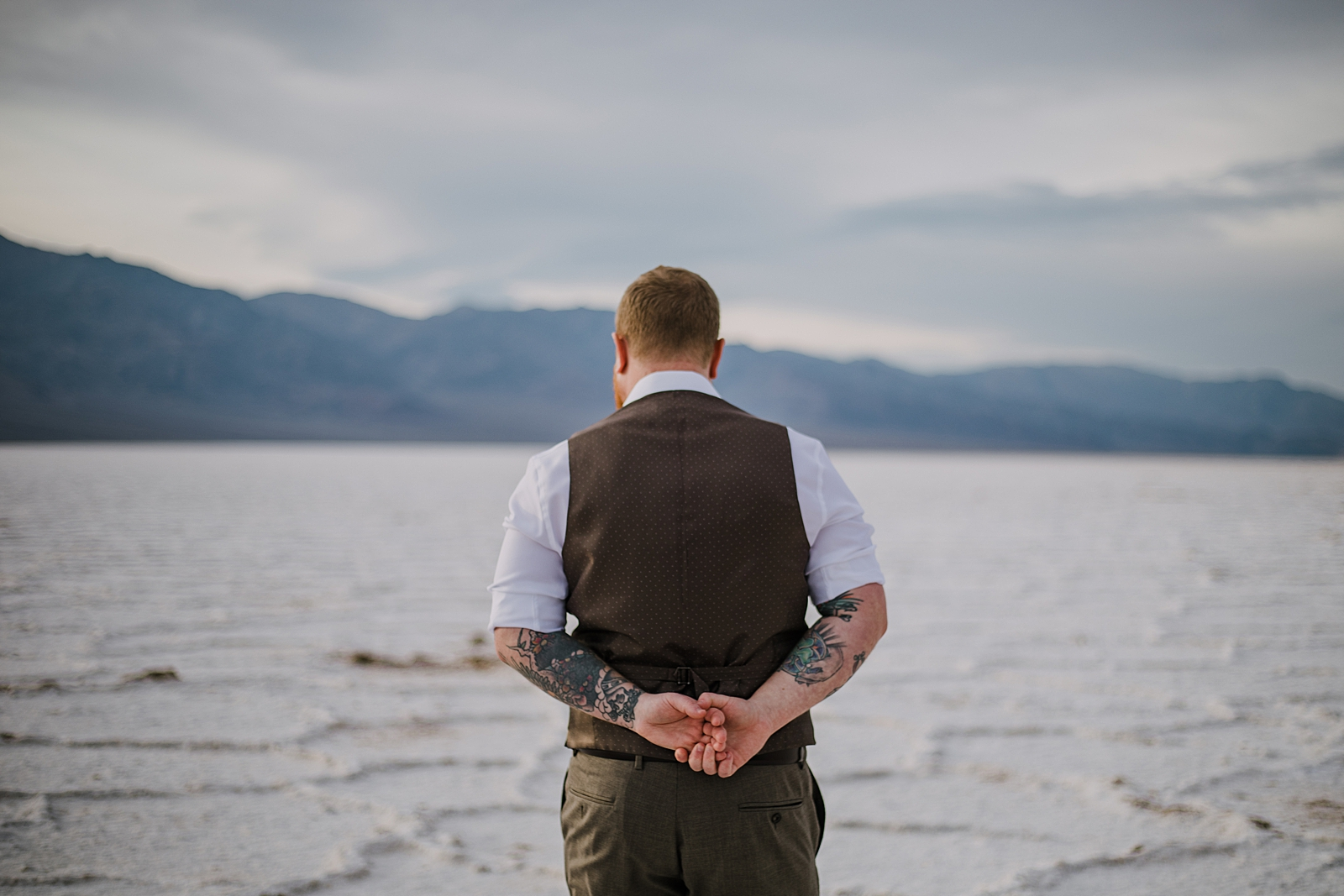 groom on the salt flats, death valley national park elopement, elope in death valley, badwater basin elopement, hiking in death valley national park, sunset at badwater basin