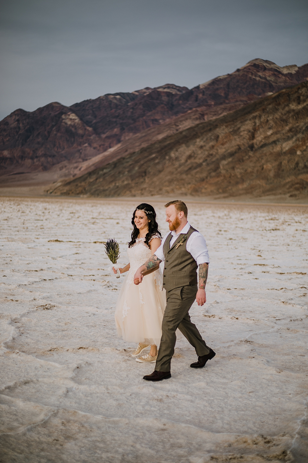 walking on the salt flats, death valley national park elopement, elope in death valley, badwater basin elopement, hiking in death valley national park, sunset at badwater basin