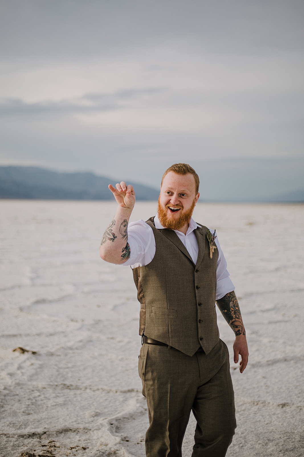 salt bae on the salt flats, death valley national park elopement, elope in death valley, badwater basin elopement, hiking in death valley national park, sunset at badwater basin