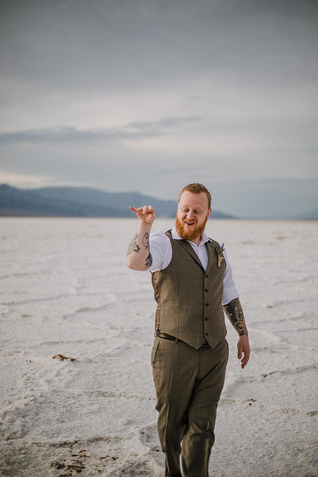 salt bae groom on the salt flats, death valley national park elopement, elope in death valley, badwater basin elopement, hiking in death valley national park, sunset at badwater basin