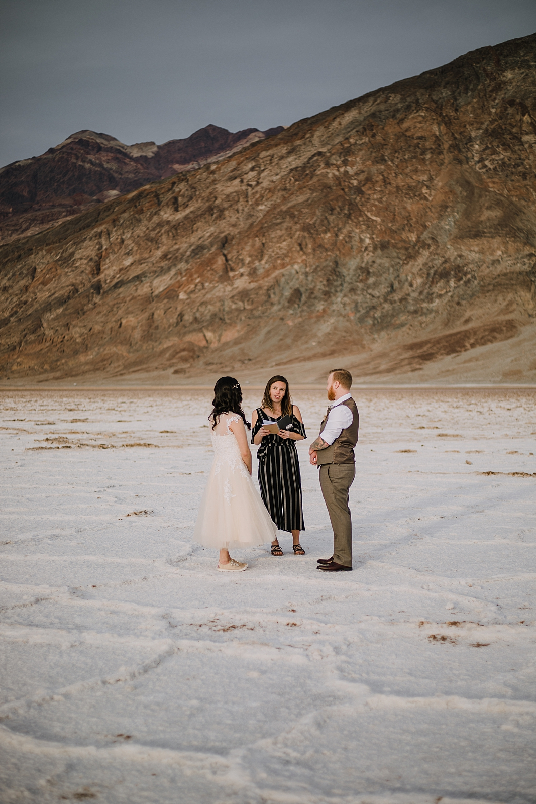 eloping on the salt flats, death valley national park elopement, elope in death valley, badwater basin elopement, hiking in death valley national park, sunset at badwater basin