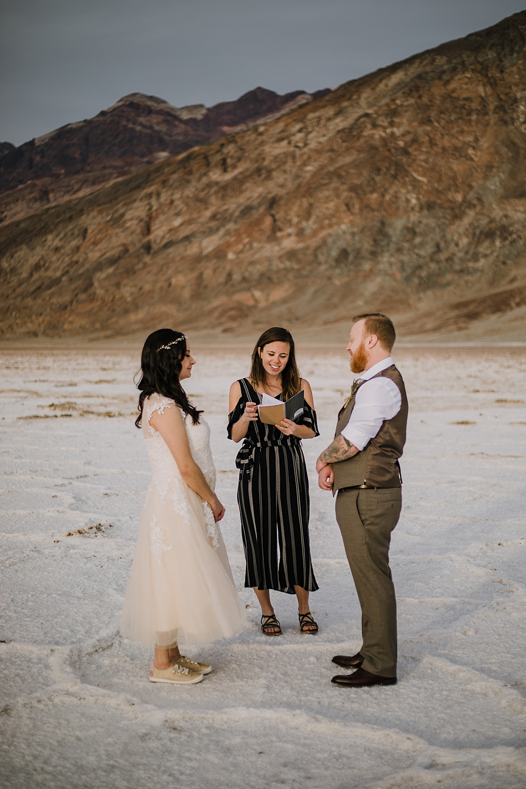 couple eloping on salt flats, death valley national park elopement, elope in death valley, badwater basin elopement, hiking in death valley national park, sunset at badwater basin