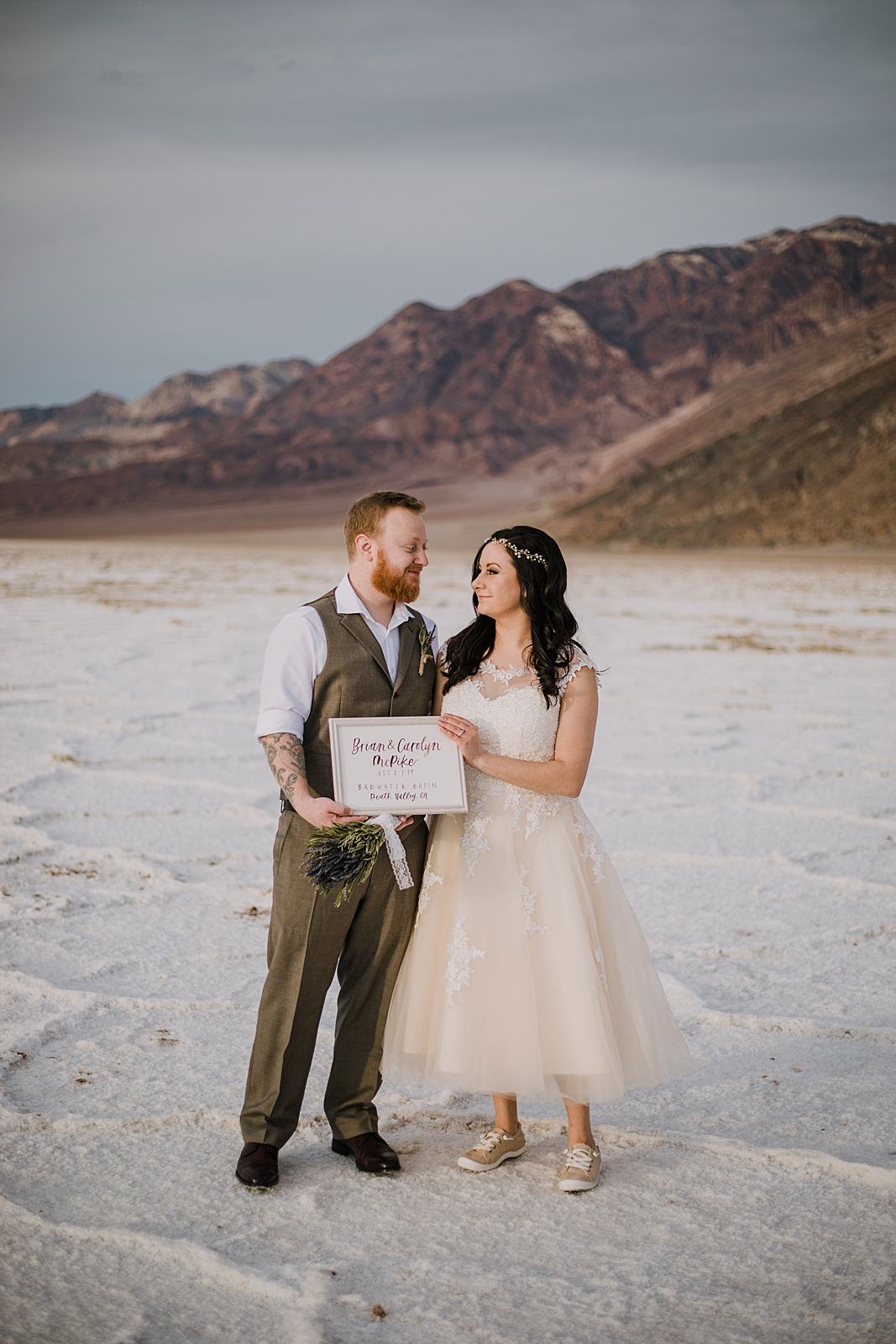 cute elopement sign, death valley national park elopement, elope in death valley, badwater basin elopement, hiking in death valley national park, sunset at badwater basin