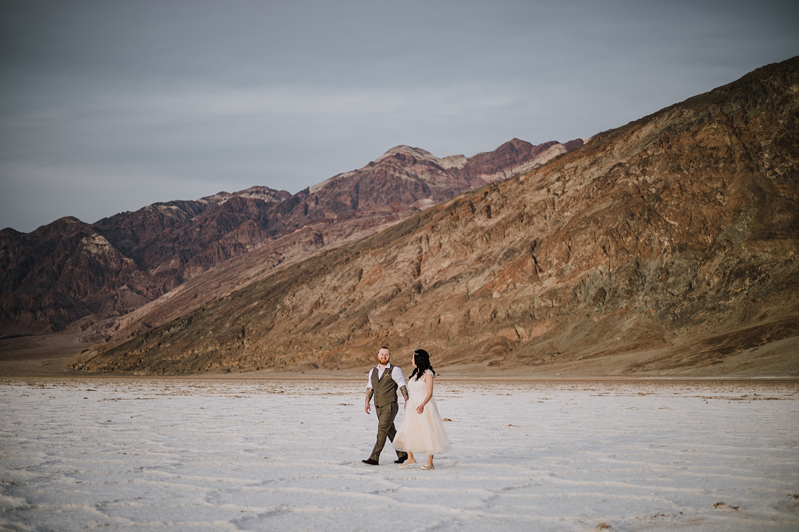 hiking across the salt flats, death valley national park elopement, elope in death valley, badwater basin elopement, hiking in death valley national park, sunset at badwater basin