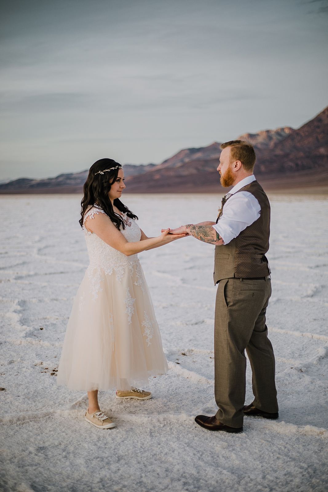 playing on the salt flats, death valley national park elopement, elope in death valley, badwater basin elopement, hiking in death valley national park, sunset at badwater basin