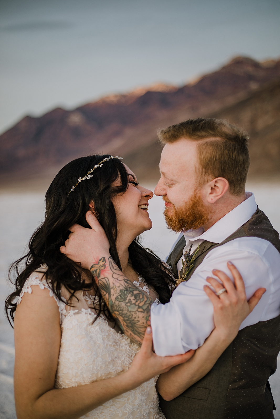 couple kissing on the salt flats, death valley national park elopement, elope in death valley, badwater basin elopement, hiking in death valley national park, sunset at badwater basin